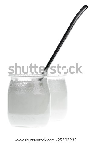 Old-fashioned yogurt jars with spoon on white background