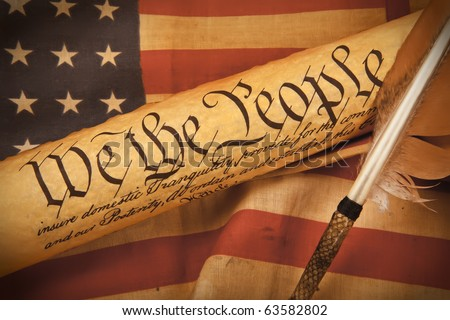 Old fashionet American Constitution - We the people  with USA Flag. - stock photo