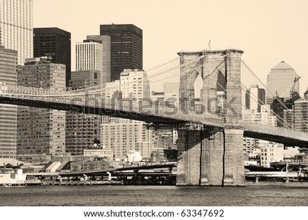 Old fation style New York City Brooklyn Bridge in Manhattan closeup with skyscrapers and city skyline over Hudson River. - stock photo
