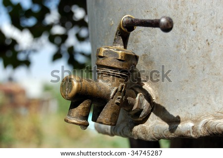 Old faucet and keg - stock photo
