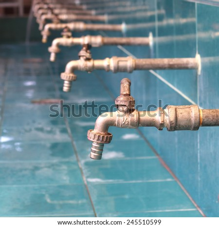 old faucet for hand washing and Defective cause wastage of water - stock photo