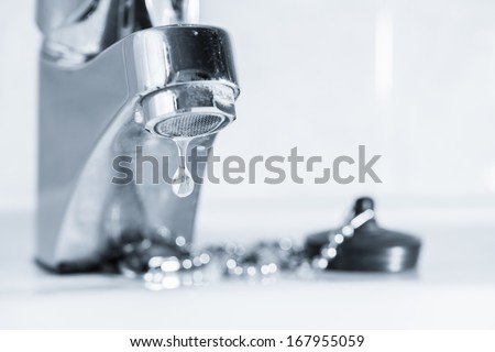 Old faucet leak out, sink in bathroom, tinted black and white image - stock photo