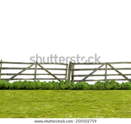 Old fence and green grass isolated on white - stock photo