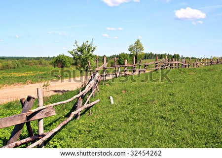 old fence on field - stock photo