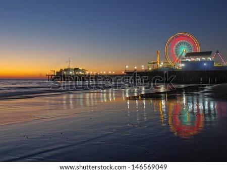 Old Ferris Wheel and Santa Monica Pier at Twilight. Santa Monica, California, USA. - stock photo