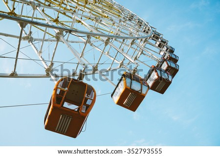 old ferris wheel at Mtatsminda Park with blue sky, stands at Mount Mtatsminda, Tbilisi