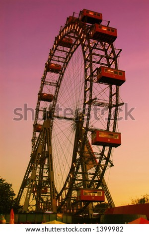 Old ferris wheel in amusement park Prater in Vienna at dusk - stock photo