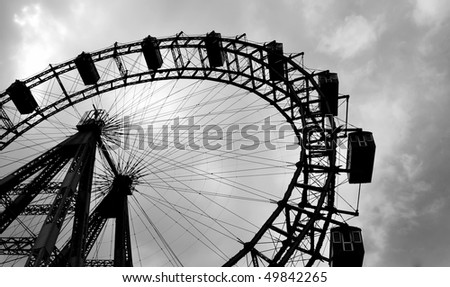 Old Ferris wheel in the amusement park Prater, Vienna, Austria. In black and white - stock photo