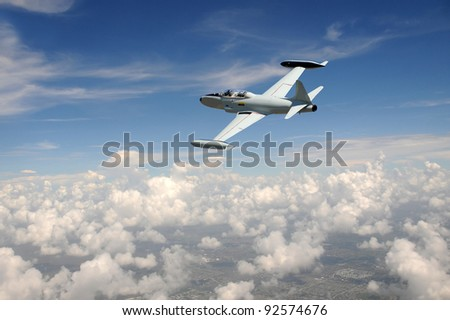 Old fighter jet soaring above the clouds - stock photo