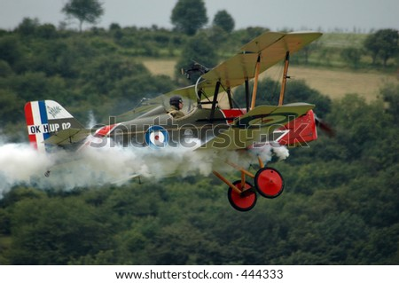 old fighter plane with smoke - stock photo