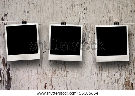 Old film blanks on a rope, historical instant photo - stock photo