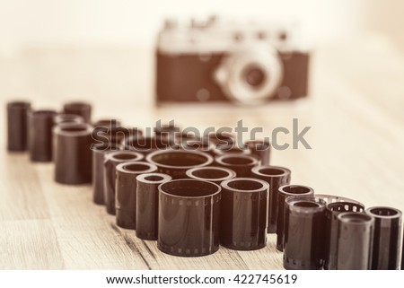 Old film camera and film rolls. Traditional photography. Darkroom. Vintage - stock photo