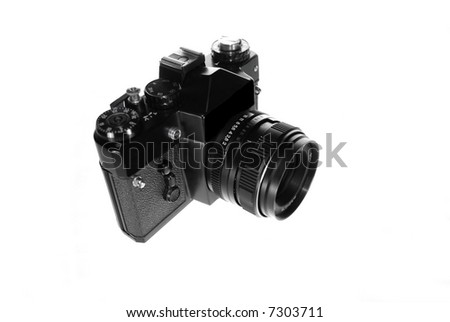 Old film camera isolated on white background