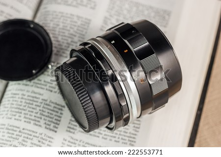 Old film camera manual focus lens - stock photo