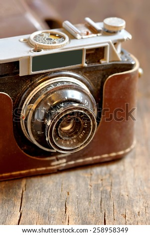 Old film camera on wooden background - stock photo