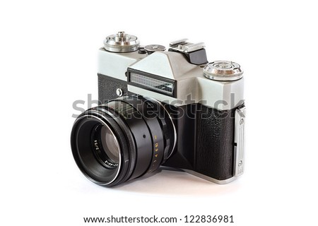 Old film camera with lens - stock photo