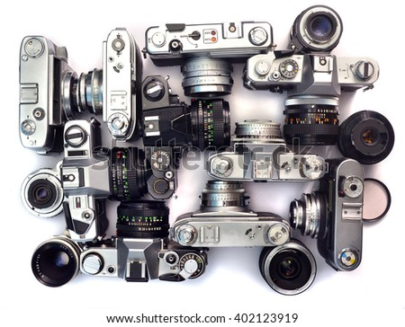 old film cameras and lenses as background - stock photo