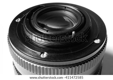 Old film DSLR lens. Metal bayonet, screw and pin aperture. Close up view. Macro. Vintage photo toning. - stock photo