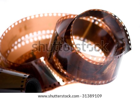 Old film roll isolated on white - stock photo