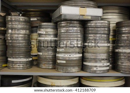 old film rolls archived in a shelf - stock photo