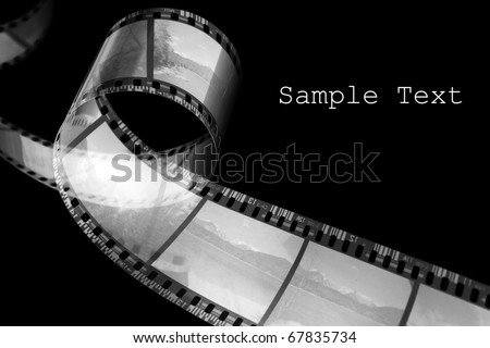 Old film strip with easy removable text. - stock photo