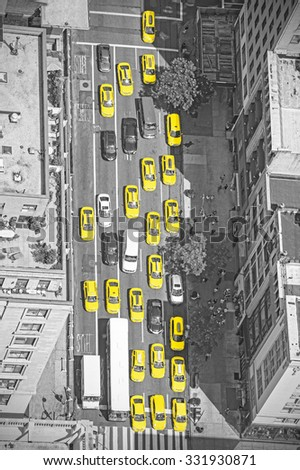 Old film style photo of New York taxis from above, black and white picture with yellow cabs, Manhattan, USA. - stock photo