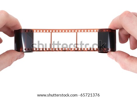 Old film with empty frame in the hands on white background - stock photo
