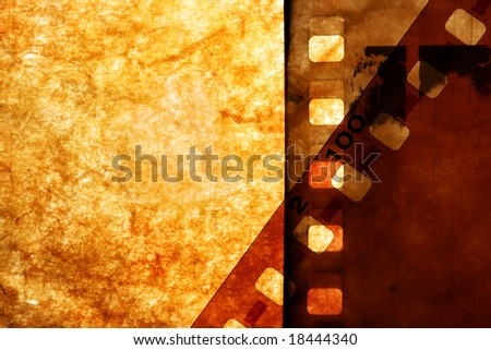 Old films over grunge paper background - stock photo