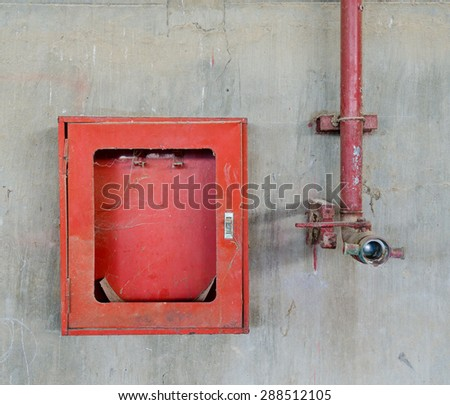 old fire hose and fire fighter box - stock photo