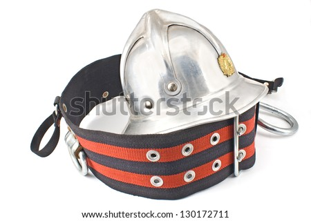 Old fireman's metallic helmet with belt isolated on white
