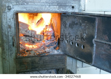 Old fireplace and door, stove, fire - stock photo
