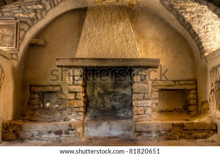 Old Fireplace in a Farmhouse Interior in Apulia, Italy - stock photo