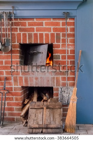 Old Fireplace with Tools  in Historic House - stock photo