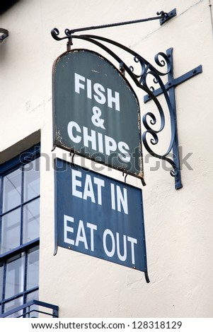 Old Fish and Chips Sign on Building Facade