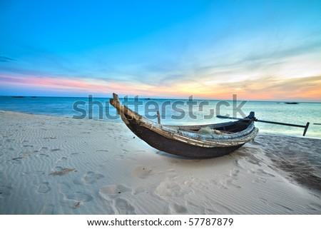 Old fisherman boat at sunrise time. Hue province. Vietnam - stock photo