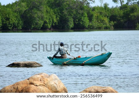 Old fisherman on the boat, Sri Lanka - stock photo