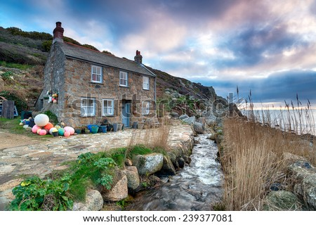 Old fisherman's cottage on the South West Coast Path at Penberth Cove, a small fishing village near Penzance in Cornwall - stock photo