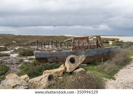 Old fishing boat abandoned on the riverbank - stock photo