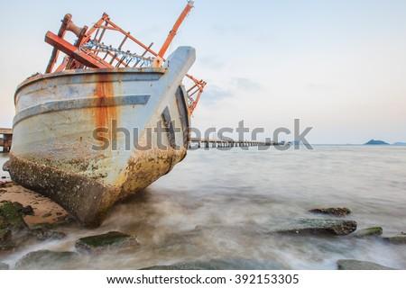 Old fishing boat aground - stock photo