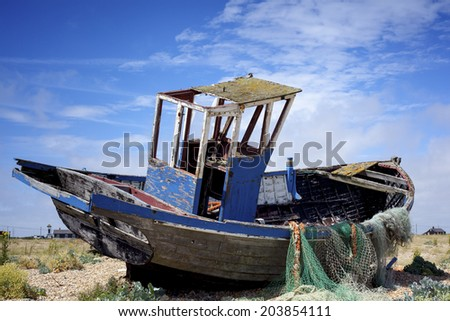 Old fishing boat. An old abandoned fishing boat stranded on a beech. - stock photo
