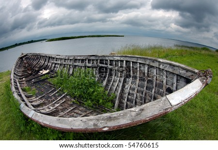 Old fishing boat by fish-eye lens - stock photo