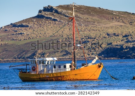 Old fishing boat hangs on anchor near South Georgia - stock photo