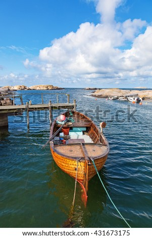 Old fishing boat moored at the pier - stock photo