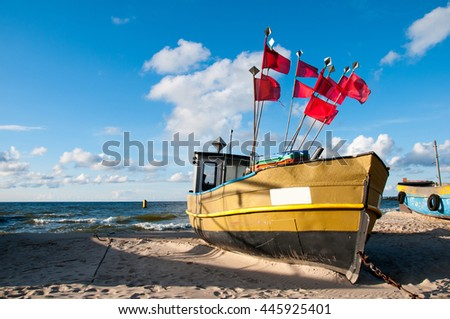 Old fishing boat moored on the beach