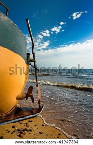 Old fishing boat on see side - stock photo
