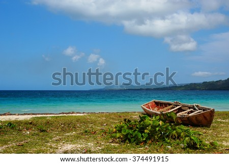 Old fishing boat on the beach in Playa rincon, Samana