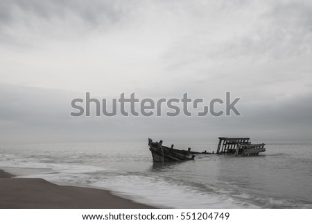 Old fishing boat wreck on the beach tone black and white