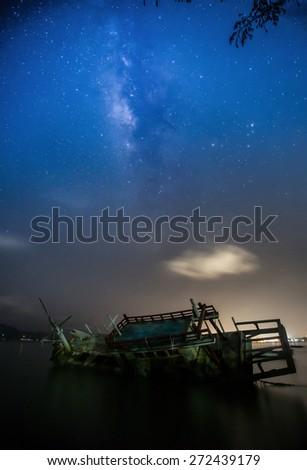 old fishing boats & galaxy - stock photo