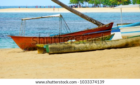 Old fishing boats on the sand of Caribbean sea coast