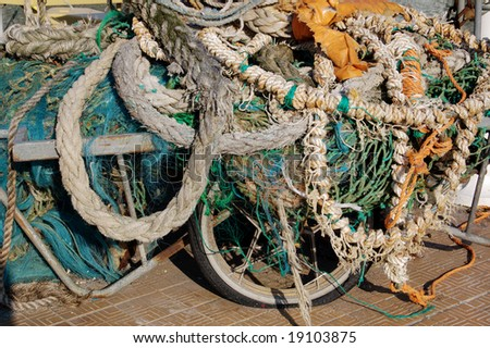 old fishing gear, ropes and nets - stock photo